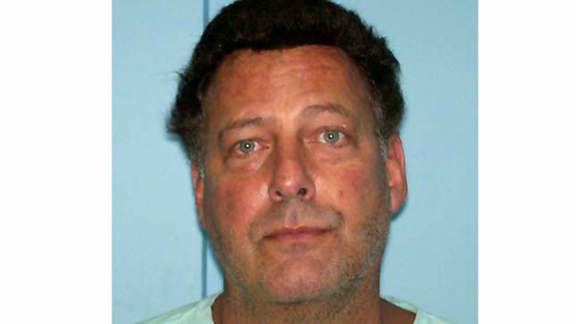 FILE - In this file photo provided Thursday Aug. 11, 2011 by Aruba police, U.S. citizen Gary V. Giordano, 50, of Gaithersburg, Maryland is shown in an Aruba police mugshot in Oranjestad, Aruba.  Giordano, detained in Aruba in the presumed death of his travel partner Robyn Gardner, had an accidental-death insurance policy on her for $1.5 million and sought to claim the money two days after reporting her missing, a person who provided information to the investigation has told The Associated Press.   (AP Photo/Aruba Police, File)
