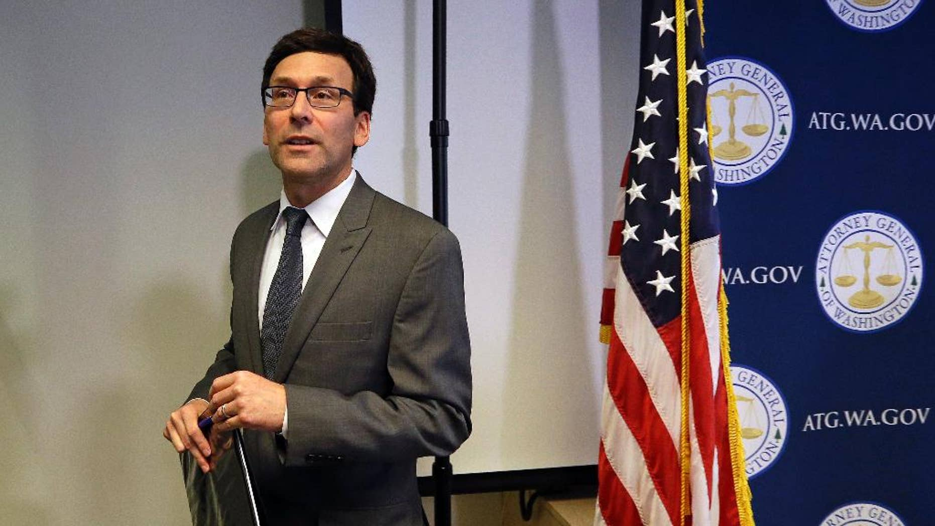 Washington State Attorney General Bob Ferguson finishes a news conference about the state's response to President Trump's revised travel ban Thursday, March 9, 2017, in Seattle. Legal challenges against Trump's revised travel ban mounted Thursday as Washington state said it would renew its request to block the executive order. It came a day after Hawaii launched its own lawsuit, and Ferguson said both Oregon and New York had asked to join his state's legal action. (AP Photo/Elaine Thompson)