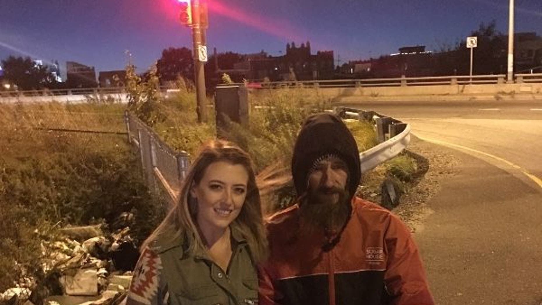 FILE: Johnny Bobbitt Jr. seen with  Kate McClure
