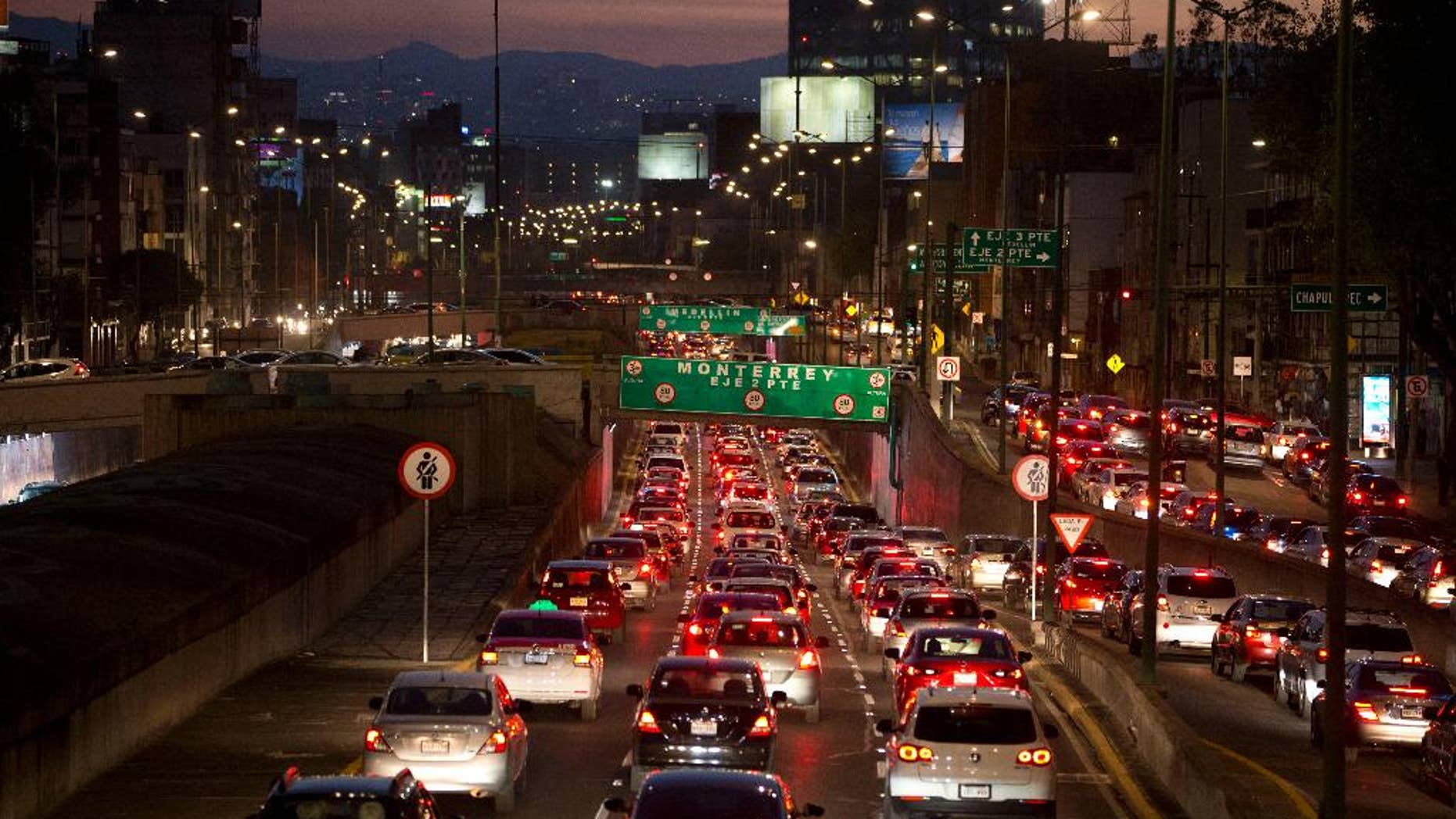 FILE - In this March 30, 2016 file photo, cars sit in evening rush hour traffic in Mexico City. Mexican authorities issued a new smog alert Saturday, May 14, 2016, for the capital after ozone levels rose above 150 percent of acceptable limits. On Sunday 20 percent of vehicles will be barred from the streets of the capital and the surrounding suburbs. If conditions don't improve, that will increase to 40 percent on Monday. (AP Photo/Rebecca Blackwell, File)
