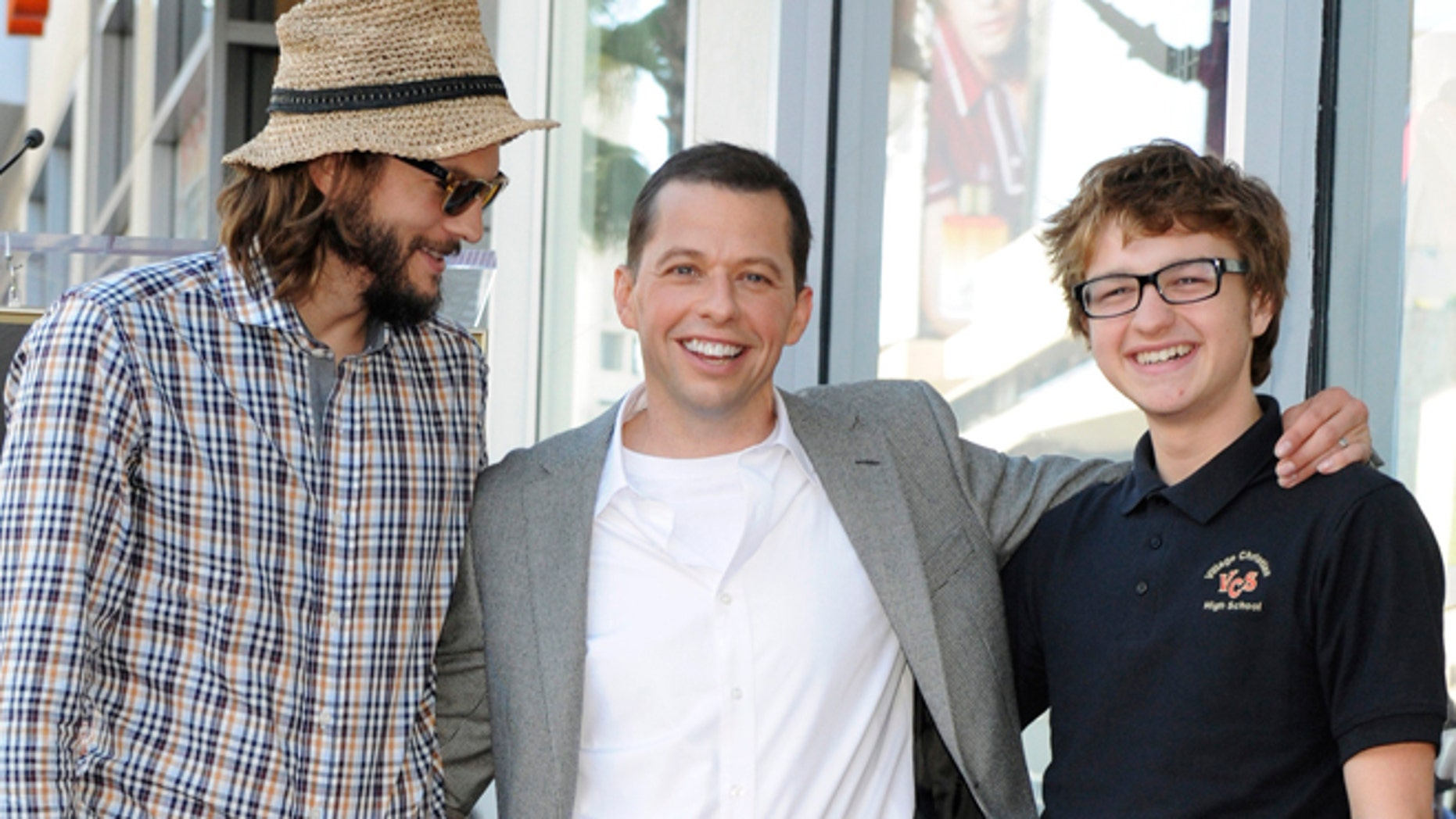 """Angus T. Jones, right, poses with his """"Two and a Half Men"""" costars."""