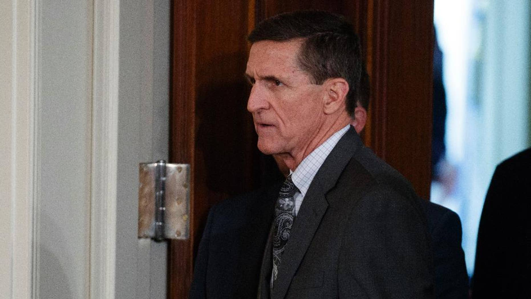 FILE - In this Feb. 13, 2017 file photo, Mike Flynn arrives for a news conference in the East Room of the White House in Washington. Targeted in widening investigations of his foreign entanglements, President Donald Trump's former national security adviser, Michael Flynn, is at odds with his former Turkish client over two unusual payments totaling $80,000 that Flynn's firm sent back last year to the client. The disagreement points to inconsistencies in Flynn's accounts to the U.S. government about his work for foreign interests.(AP Photo/Evan Vucci, File)