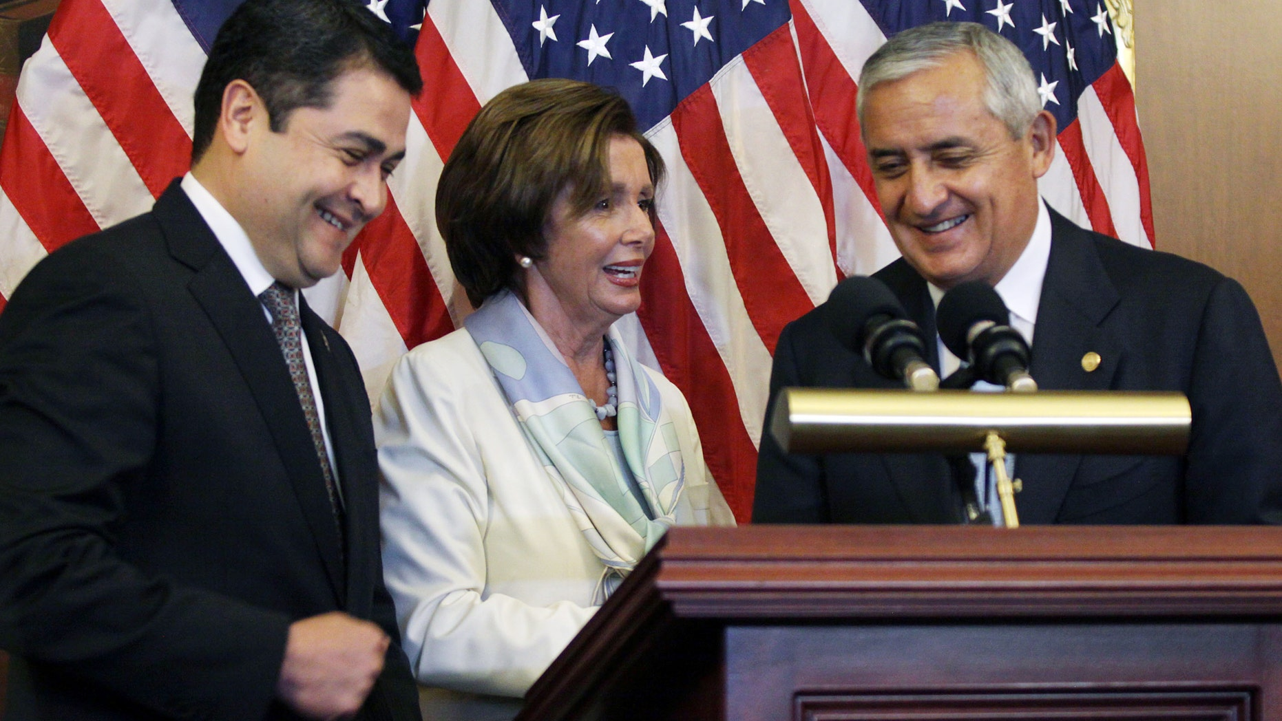 Rep. Nancy Pelosi with Guatemalan President Otto Molina, right, and Honduran President Juan Hernández.