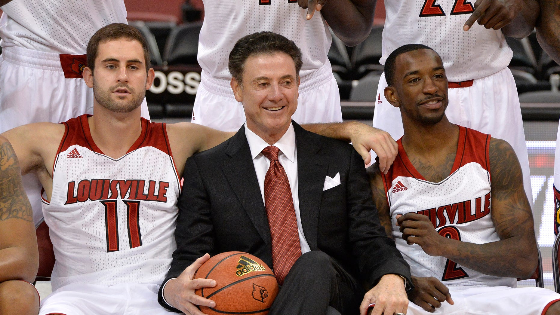 Louisville's Luke Hancock, left, head coach Rick Pitino, center, and Russ Smith pose for the cameras during NCAA college basketball media day, Saturday, Oct. 12, 2013, in Louisville, Ky. (AP Photo/Timothy D. Easley)