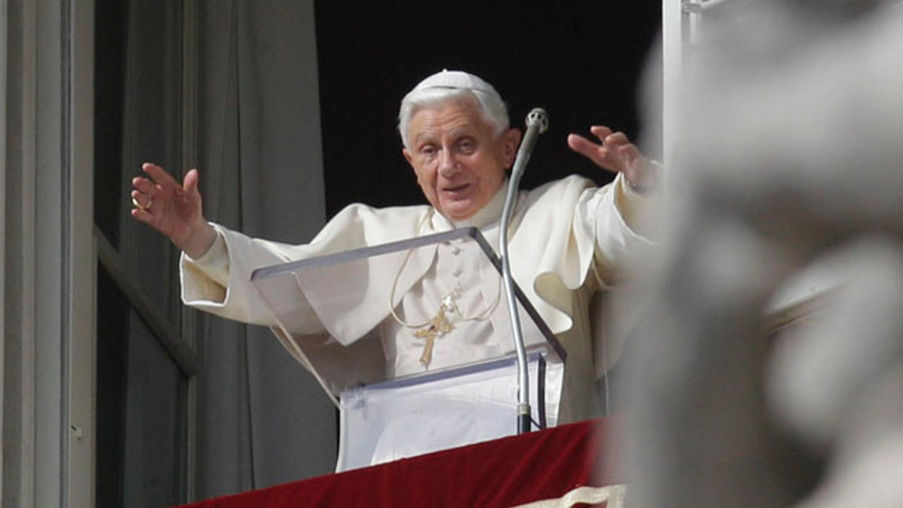 Pope Benedict XVI delivers his message during his Angelus prayer from his studio window overlooking St. Peter's Square at the Vatican, Sunday, Nov. 14, 2010.