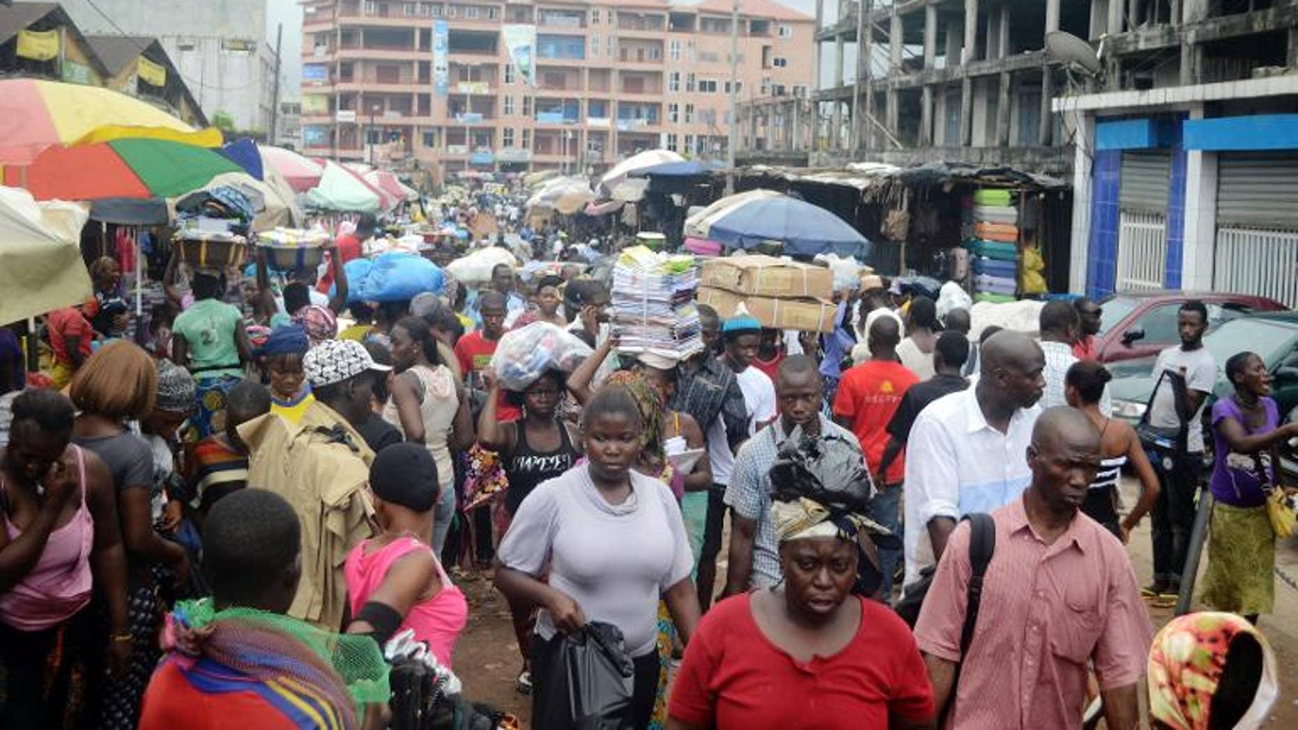 People walking in Conakry street, Guinea, September 24, 2013
