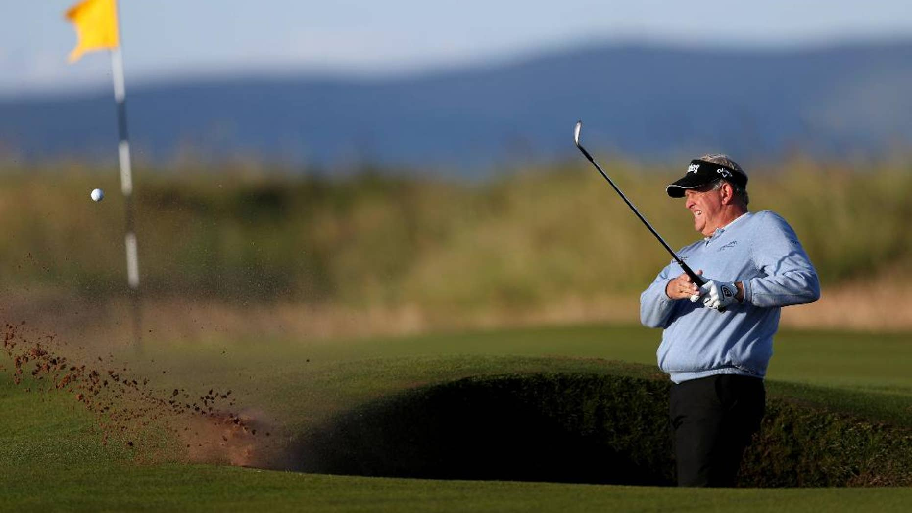 Scotland's Colin Montgomerie plays out of the bunker on the first hole during the first round of the British Open Golf Championship at the Royal Troon Golf Club in Troon, Scotland, Thursday, July 14, 2016. (David Davies/PA via AP)