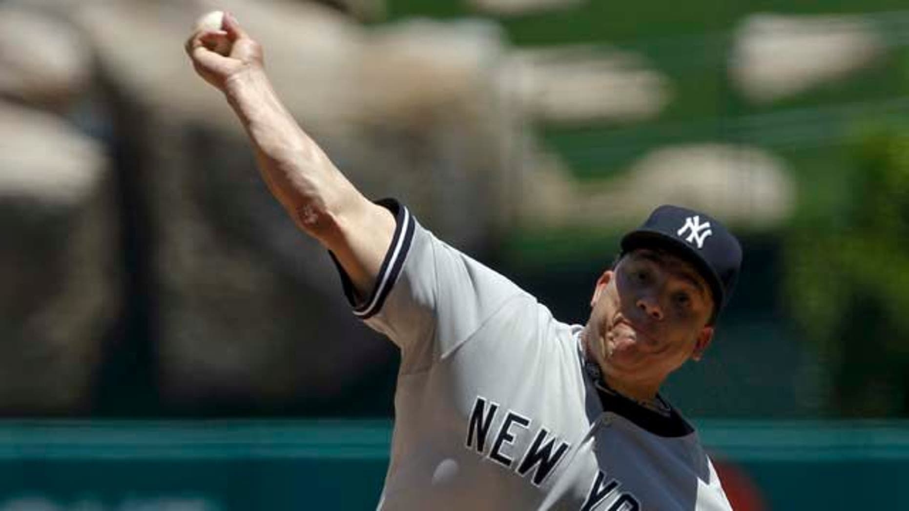 New York Yankees starting pitcher Bartolo Colon throws against the Los Angeles Angels during the first inning of a baseball game, Sunday, June 5, 2011, in Anaheim, Calif. (AP Photo/Chris Carlson)