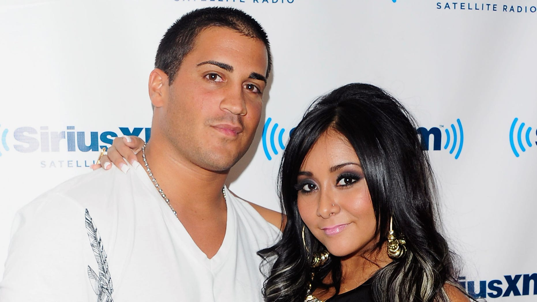 """NEW YORK, NY - AUGUST 11:  Jionni LaValle and TV personality Nicole """"Snooki"""" Polizzi visit SiriusXM's studio on August 11, 2011 in New York City.  (Photo by Andrew H. Walker/Getty Images)"""