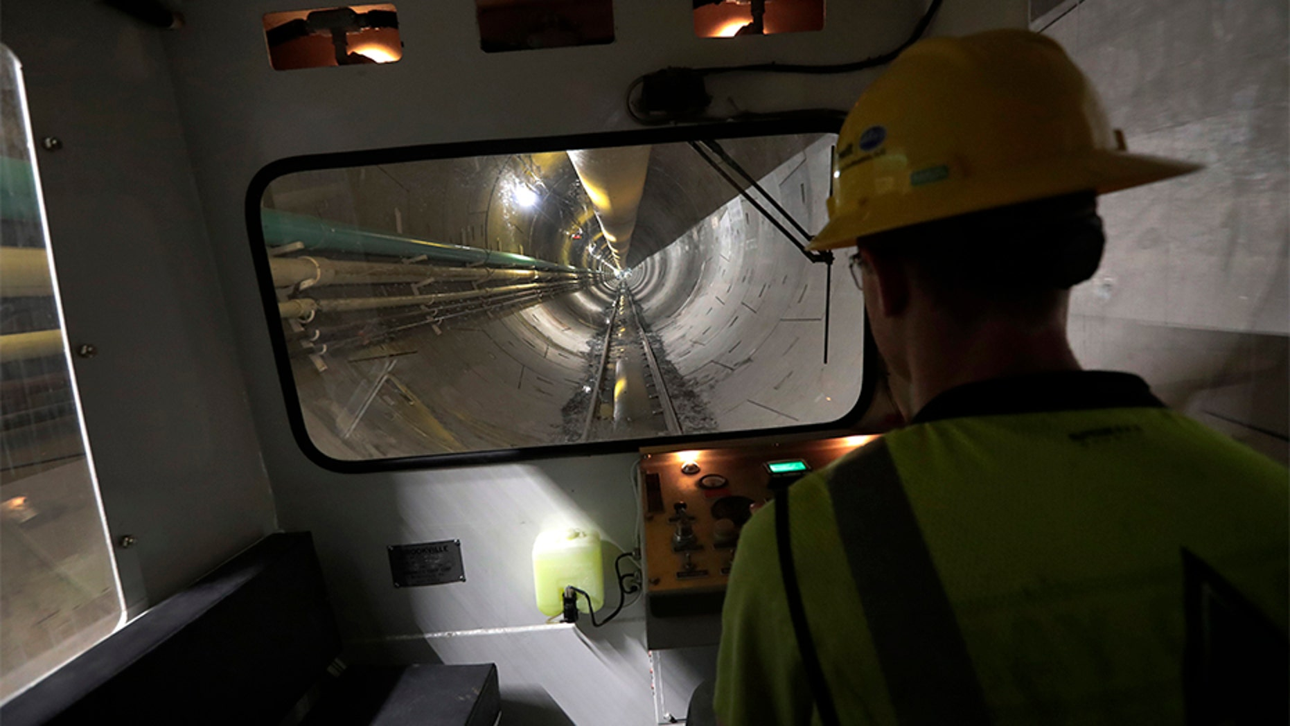 On May 16, operator Andrew Reisinger drives a personnel shuttle along a small gauge rail line inside a 2.5 - mile bypass tunnel being dug for the Delaware Aqueduct, in Marlboro, N.Y.