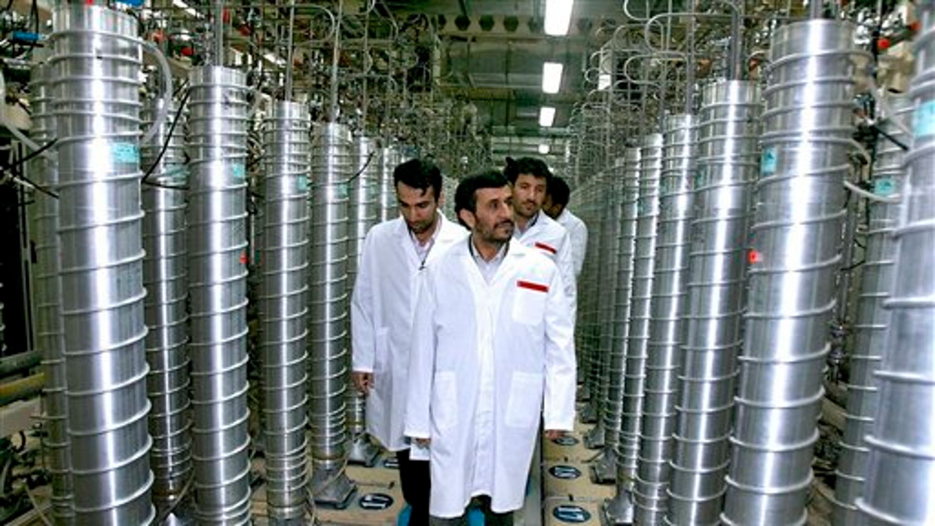 2008: Iranian President Mahmoud Ahmadinejad visits the Natanz Uranium Enrichment Facility in Iran.