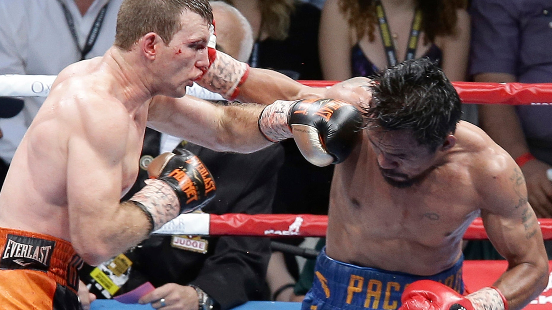 Jeff Horn of Australia, left, and Manny Pacquiao of the Philippines, right, lands a left to during their WBO World Welterweight title fight in Brisbane.
