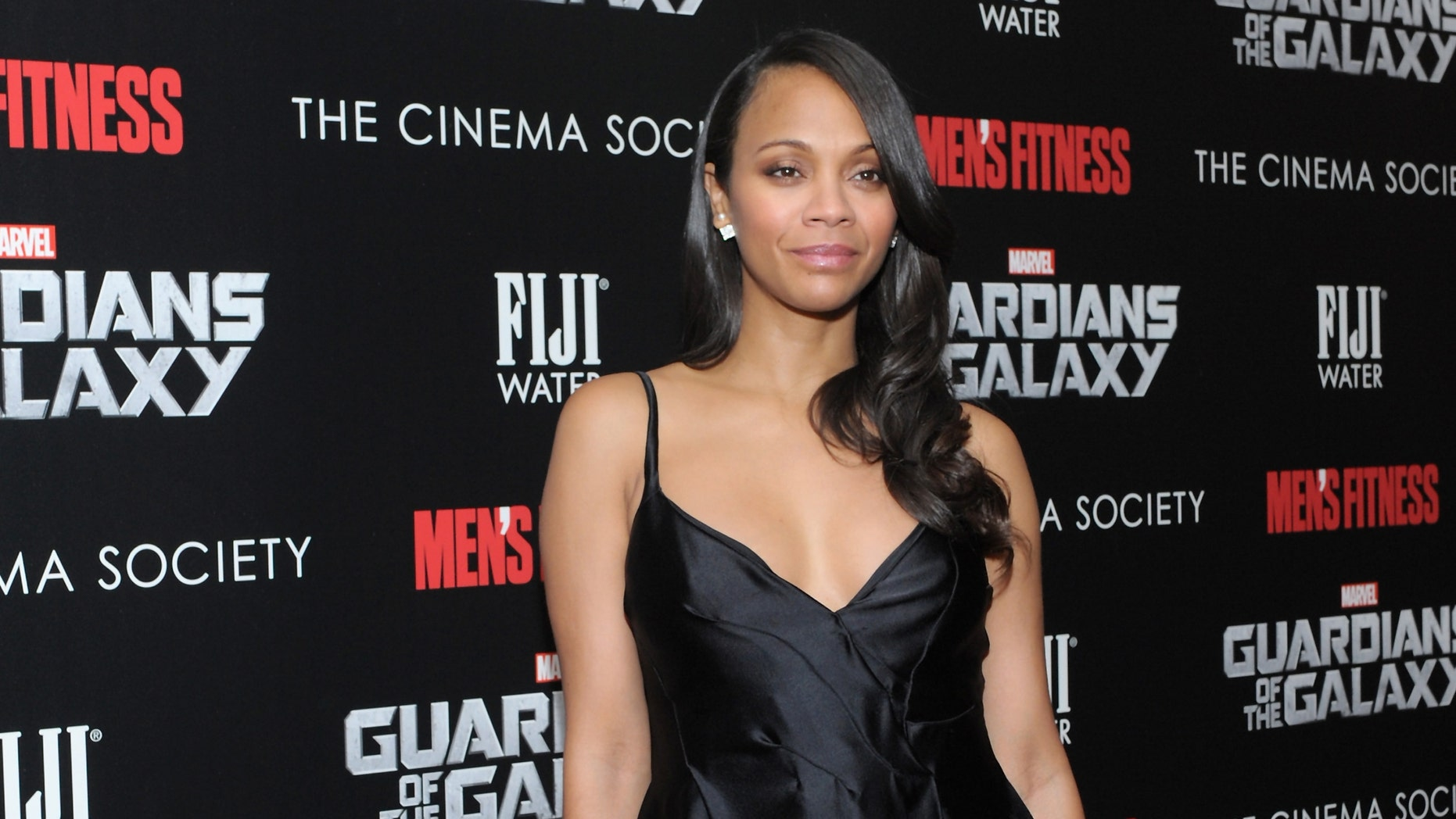 """NEW YORK, NY - JULY 29:  Actress Zoe Saldana attends The Cinema Society with Men's Fitness & FIJI Water host a screening of """"Guardians of the Galaxy"""" on July 29, 2014 in New York City.  (Photo by Andrew Toth/Getty Images for FIJI Water)"""