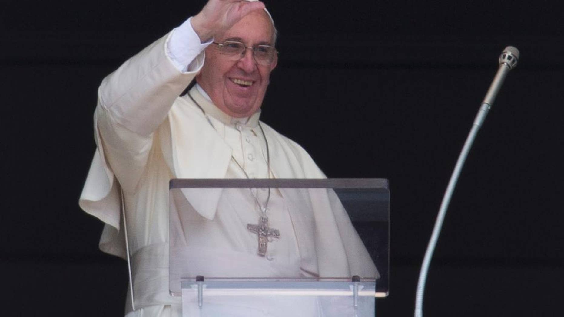Pope Francis waves during the Regina Coeli prayer from his studio's window overlooking St. Peter's Square, at the Vatican, Sunday, May 1,  2016. (AP Photo/Alessandra Tarantino)