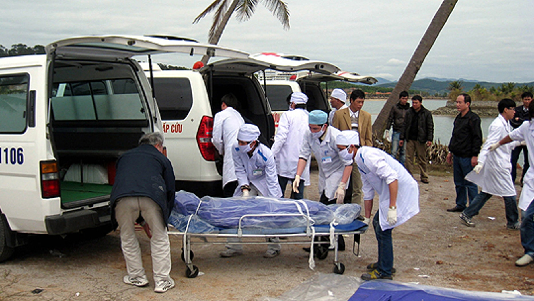 Feb. 17: Vietnamese health workers load the body of a sunken tourist boat victim to an ambulance in northern province of Quang Ninh, Vietnam.