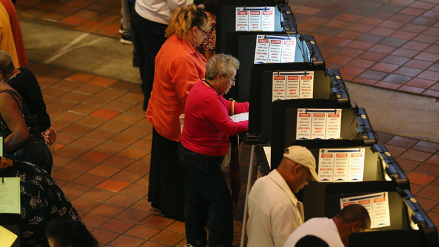 MIAMI, FL - OCTOBER 27:  Early voters fill out their ballots as they cast their vote in the presidential election on the first day of early voting, at the Stephen P. Clark Government Center on October 27, 2012 in Miami, Florida. Early voting in one of the important swing states is held for eight straight 12-hour days, leading up to the November 6 general election.  (Photo by Joe Raedle/Getty Images)