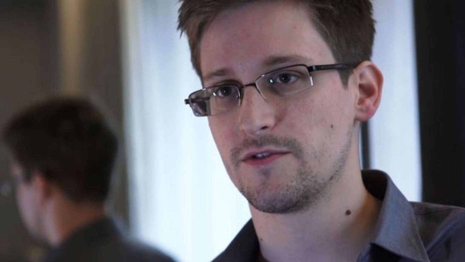 Edward Snowden, a former contractor for the National Security Agency, speaks during an interview with The Guardian newspaper in Hong Kong, June 6, 2013. Russian President Vladimir Putin and US President Barack Obama have ordered the chiefs of their respective security agencies to find a way out of the impasse caused by Snowden's stay in a Moscow airport, a senior official said on Monday.