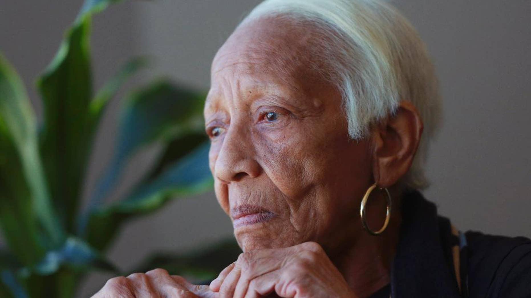 FILE - In this Jan. 11, 2016, file photo, Doris Payne speaks during an interview in Atlanta. Payne, a well-known jewel thief who reflected on her six-decade criminal career in a 2013 documentary, has been deemed too ill to stand trial for an alleged 2015 theft. The Atlanta Journal-Constitution reported Payne's trial was scheduled to start Feb. 21, 2017, in connection with the theft of a pair of Christian Dior earrings from a Saks Fifth Avenue store. (AP Photo/John Bazemore, File)