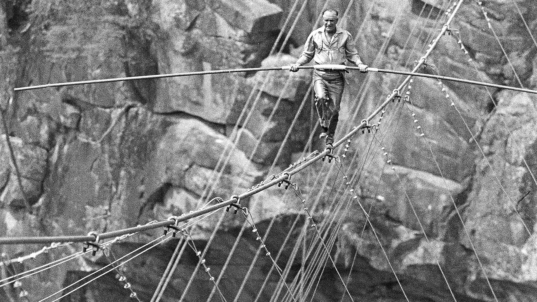 FILE -I n this July 18, 1970 file photo, Karl Wallenda walks across the cable at the nearly 1,000-foot deep Tallulah Gorge, Ga. His great-grandson Nik Wallenda hopes to accomplish the same feat in the near future. (AP Photo/Bob Schutz)
