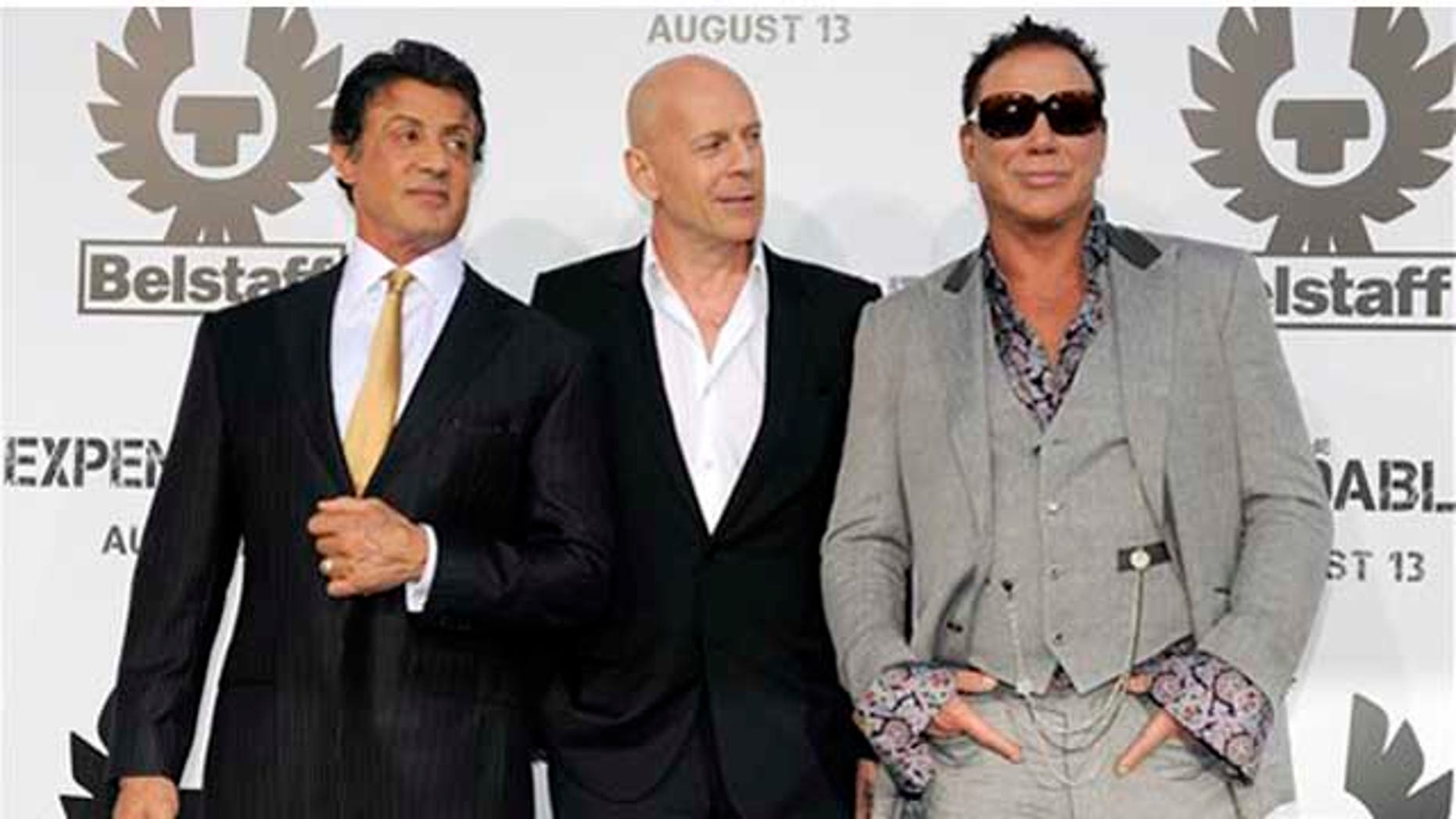 """Aug. 3: Sylvester Stallone, Bruce Willis and Mickey Rourke pose together at the premiere of """"The Expendables"""" in Los Angeles."""