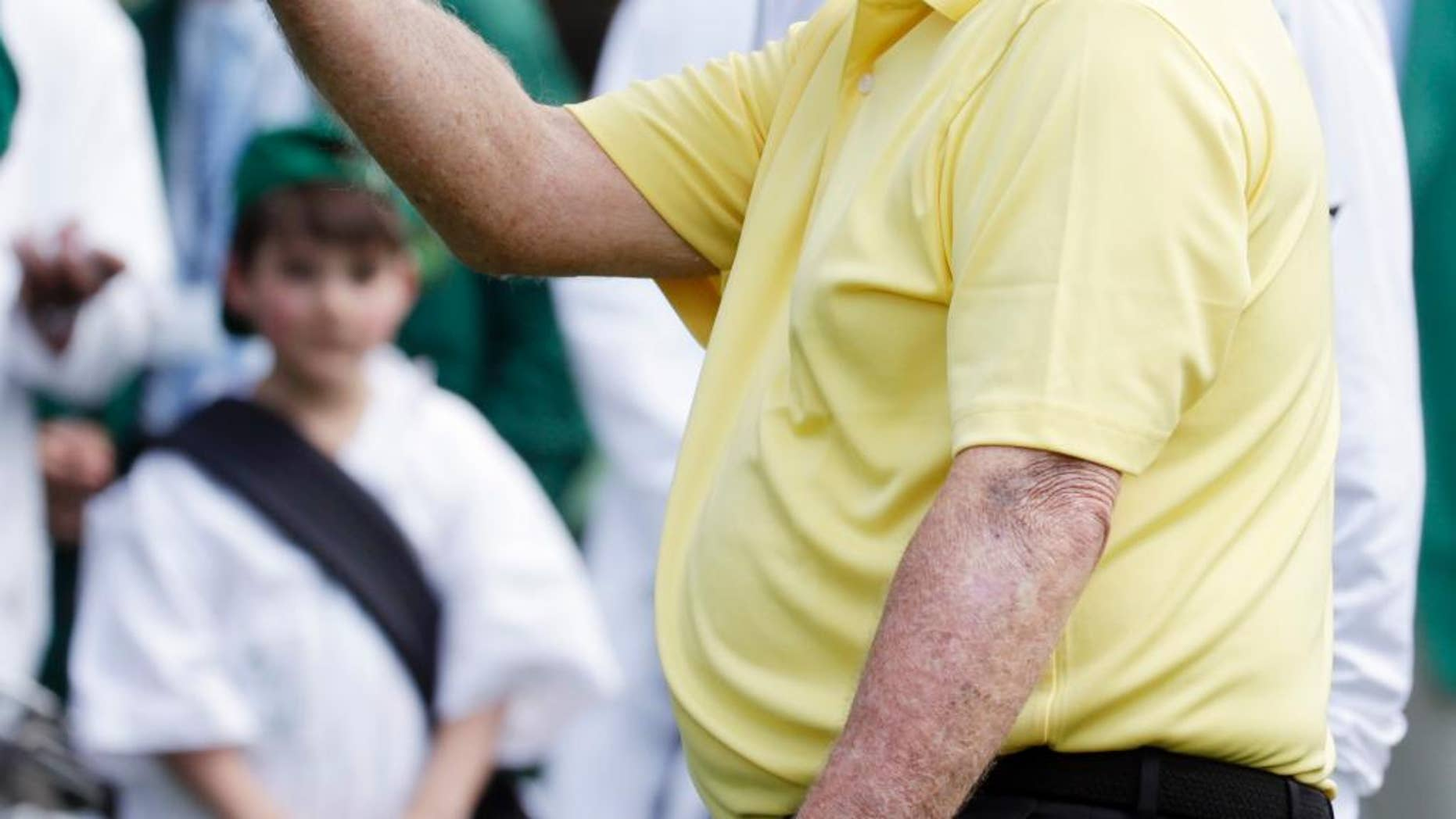 Jack Nicklaus watches his tee shot during the Par 3 contest at the Masters golf tournament Wednesday, April 8, 2015, in Augusta, Ga. (AP Photo/Darron Cummings)
