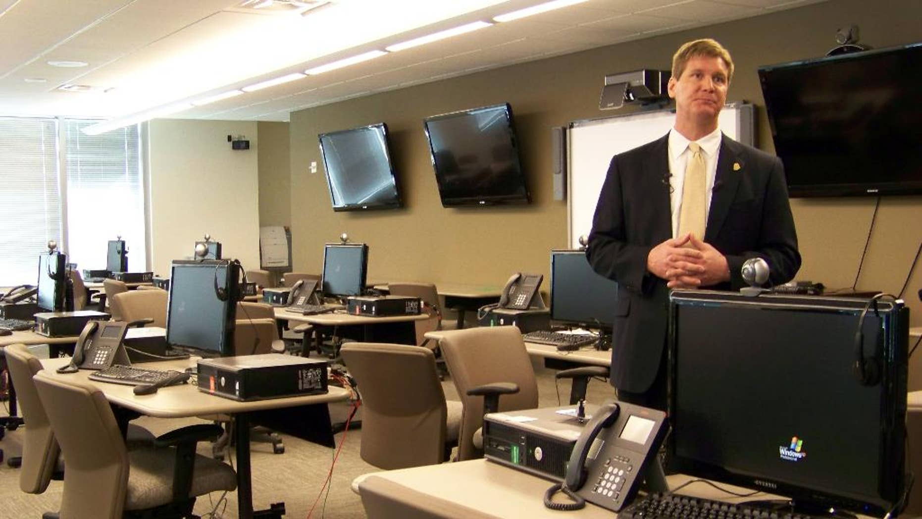 File- This March 9, 2012, file photo shows FBI spokesman Kyle Loven giving a tour of the Emergency Operations Center at the new Minneapolis-area field office in Brooklyn Center, Minn. Loven, spokesman for the Minneapolis office of the FBI, said six people were arrested Sunday, April 19, 2015, but gave no further details. An FBI spokesman in San Diego referred questions to Loven. (AP Photo/Amy Forliti, File)