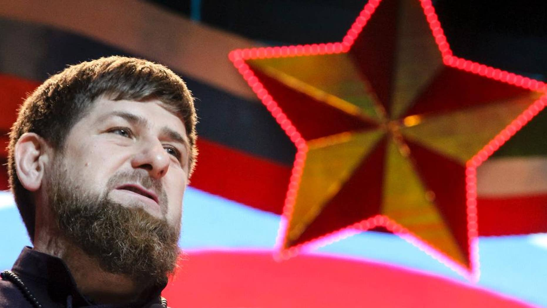"""FILE - In this file photo dated Saturday, Feb. 20, 2016, Chechen regional leader Ramzan Kadyrov attends celebrations marking Defenders of the Fatherland Day in Chechnya's provincial capital Grozny, Russia. Kadyrov said Thursday Dec. 12, 2016, that Chechen troops will be happy to fight the """"scum"""" in Syria, after Russian media reported Chechen military police would deploy to protect the Russian air base in Syria and perform other tasks. (AP Photo/Musa Sadulayev, FILE)"""