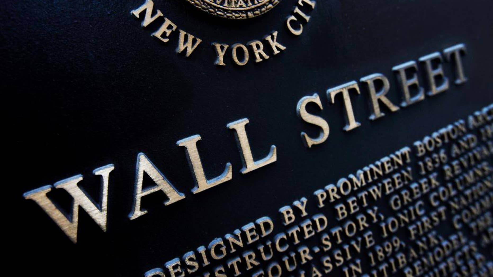 FILE - This Jan. 4, 2010 file photo shows an historic marker on Wall Street in New York.  Japan's stock benchmark closed above the 20,000-level for the first time in 15 years Wednesday, April 22, 2015, encouraged by the country's first monthly trade surplus since 2012. European stocks fell, however, and Wall Street was expected to open lower. (AP Photo/Mark Lennihan, File)