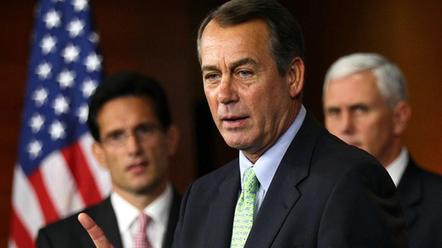 Sept. 29: Minority Leader Rep. John Boehner speaks as House Minority Whip Rep. Eric Cantor and Rep. Mike Pence listen on Capitol Hill.