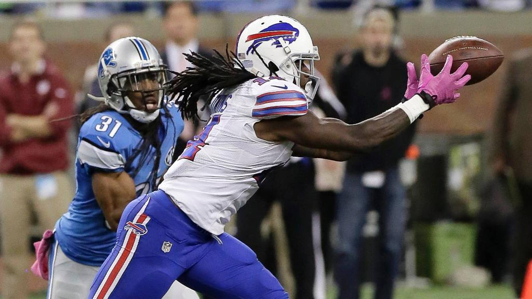 Buffalo Bills wide receiver Sammy Watkins (14) catches a 20-yard pass as Detroit Lions cornerback Rashean Mathis (31) watches in the fourth quarter of an NFL football game Sunday, Oct. 5, 2014, in Detroit. The Bills defeated the Lions 17-14. (AP Photo/Duane Burleson)