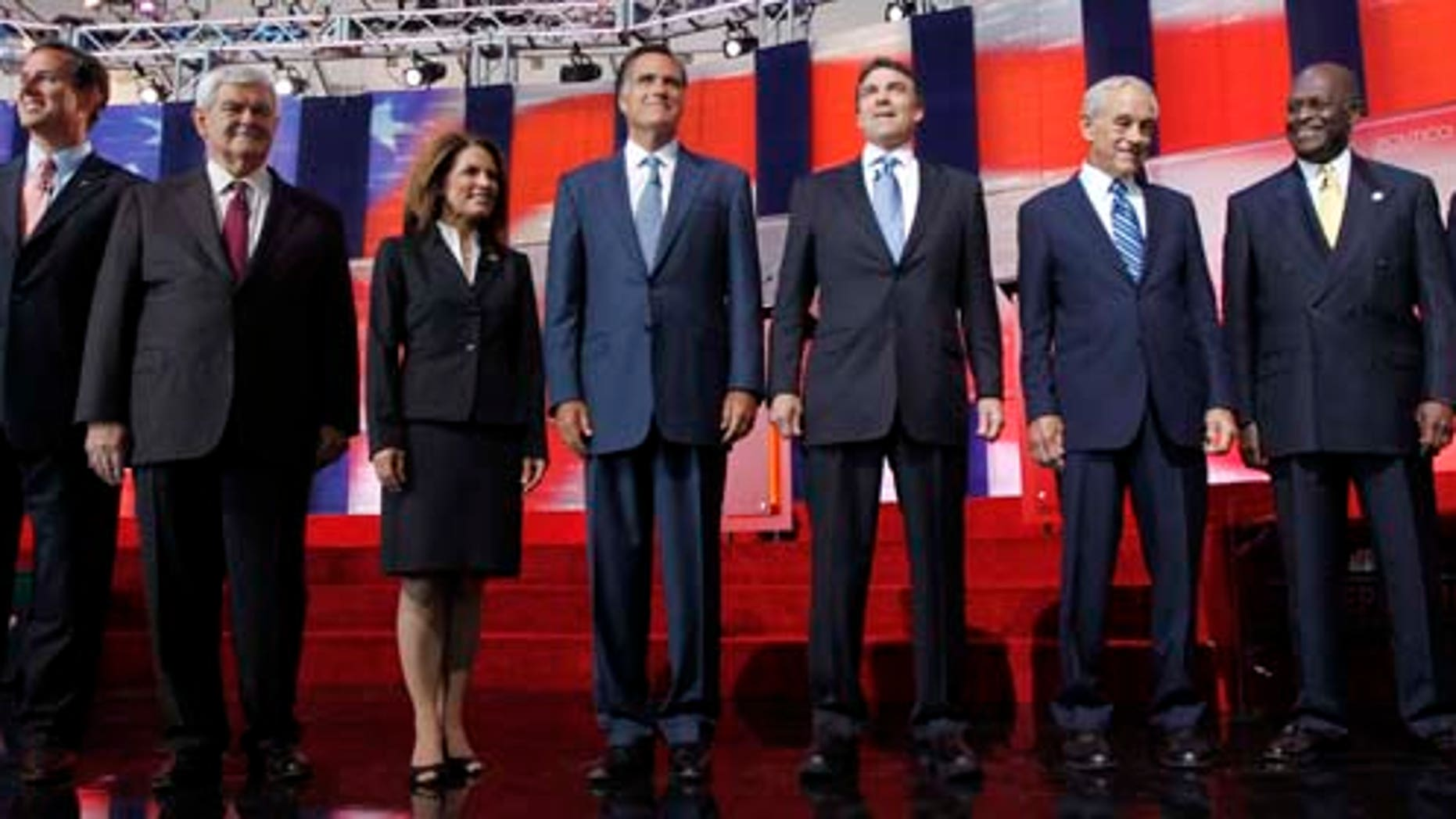 FILE - In this Sept. 7, 2011, file photo Republican presidential candidates stand together before a Republican presidential candidate debate at the Reagan Library in Simi Valley, Calif. They will debate again on Sept. 22, 2011, in Orlando. (AP Photo/Chris Carlson, File)