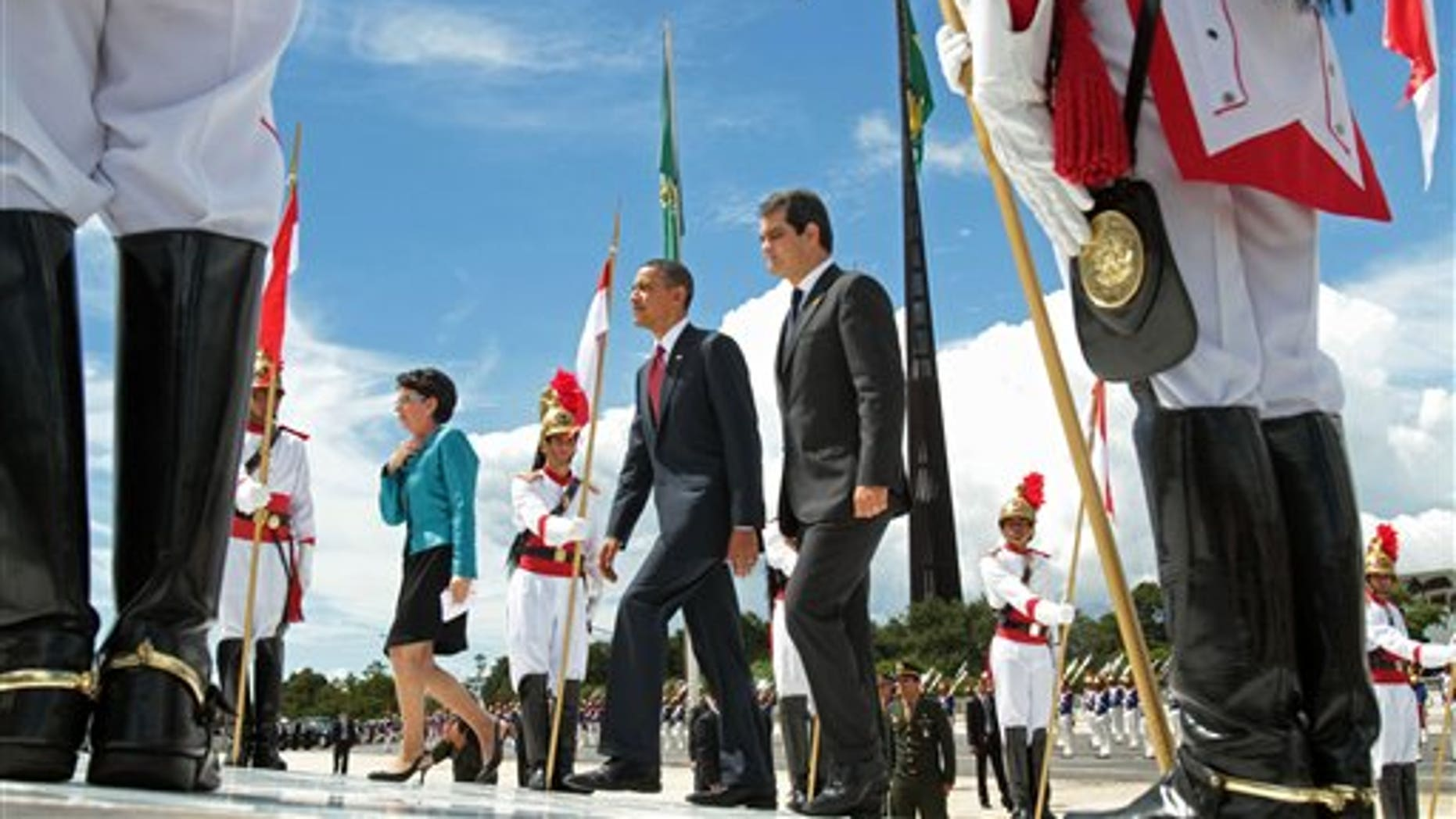 U.S. President Barack Obama, center, arrives to Planalto palace in Brasilia, Brazil, Saturday March 19, 2011. Obama arrived in Brazil on Saturday for the start of a three-country, five-day tour of Latin America. (AP Photo/Eraldo Peres)