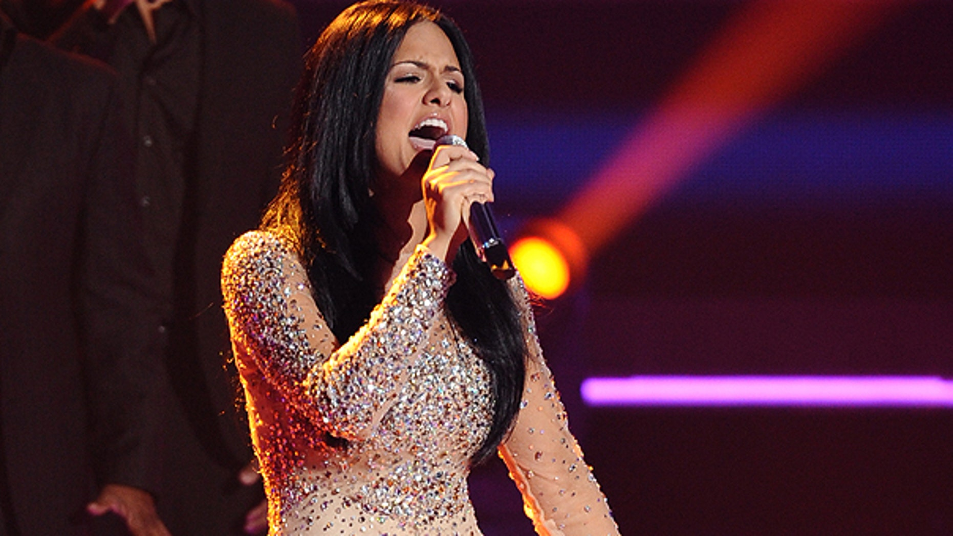 March 30: In this photo released by Fox, Pia Toscano performs in front of the judges on the singing competition series, 'American Idol,' in Los Angeles.