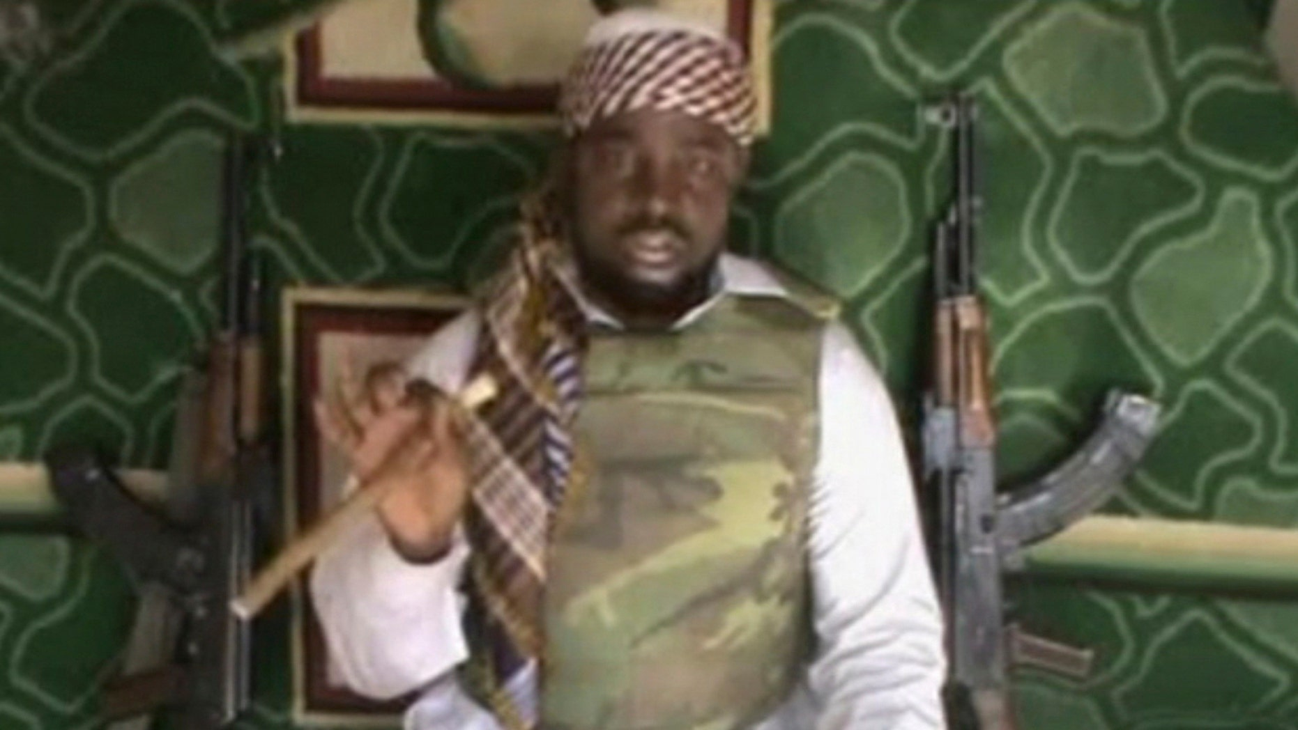 FILE: This file image made available from Wednesday, Jan. 10, 2012,  taken from video posted by Boko Haram sympathizers shows the leader of the radical Islamist sect Imam Abubakar Shekau. The leader of an Islamic uprising in northeastern Nigeria boasts in a new video of a daring attack on military bases in a provincial capital and threatens to attack the United States next, it has been reported on Thursday, Dec. 12, 2013.  Few believe the Boko Haram terrorist network has such capability though there are fears its insurgency could spread to neighboring states. In  his first statement since Washington designated Boko Haram a terrorist network last month, Abubakar Shekau swore at the United States, calling it a prostitute nation of infidels and liars. The United States in July posted a reward of $7 million for information leading to Shekau's arrest. (AP Photo, File ) THE ASSOCIATED PRESS CANNOT INDEPENDENTLY VERIFY THE CONTENT, DATE, LOCATION OR AUTHENTICITY OF THIS MATERIAL