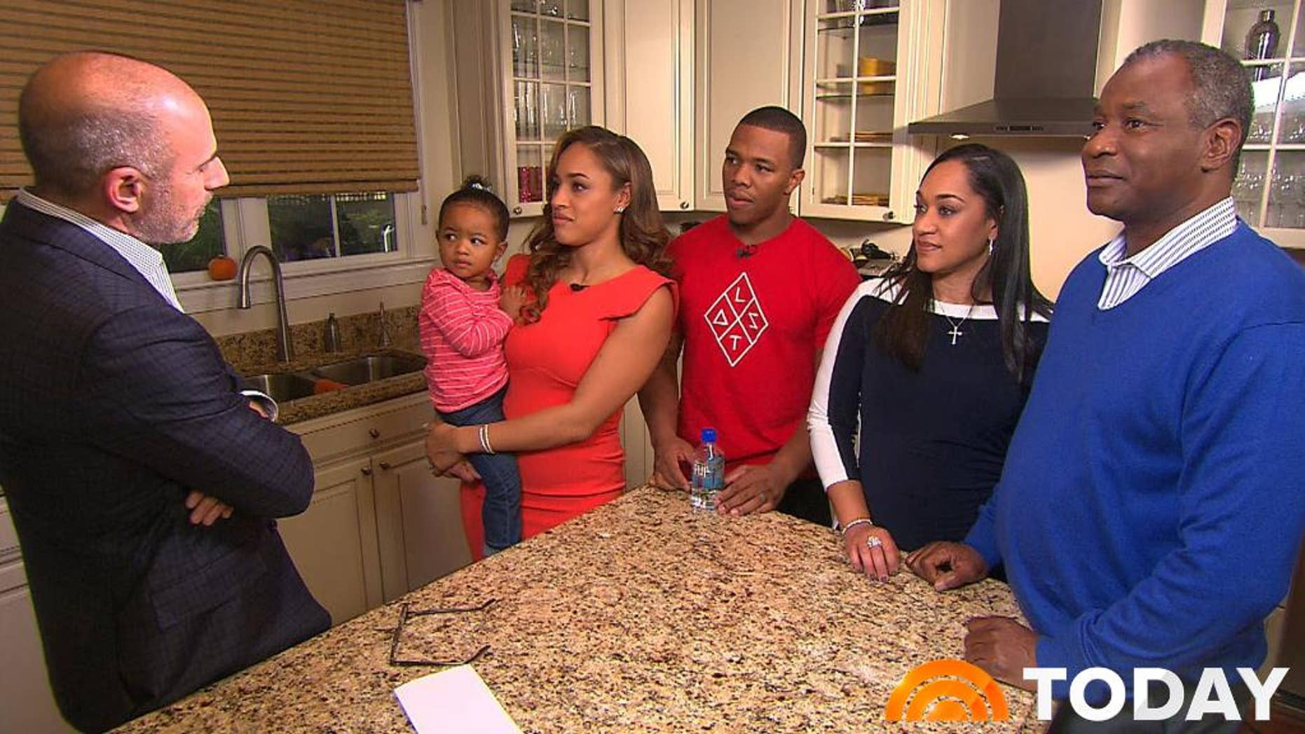 "In this image from video provided by The Today Show, host Matt Lauer, left, interviews Janay Rice, holding daughter Rayven, and Ray Rice. Joining them are Janay's parents, Candy and Joe Palmer, right. Janay Rice says NFL Commissioner Roger Goodell wasn't being honest when he said Ray Rice was ""ambiguous"" about hitting her in a casino elevator. (AP Photo/The Today Show)"