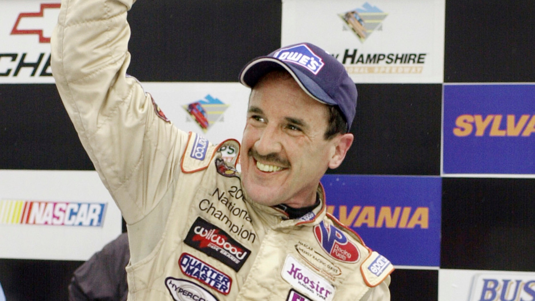 In this Sept. 16, 2005 file photo, Ted Christopher celebrates his victory in the Busch North Series Sylvania 125 at the New Hampshire International Speedway in Loudon, N.H.
