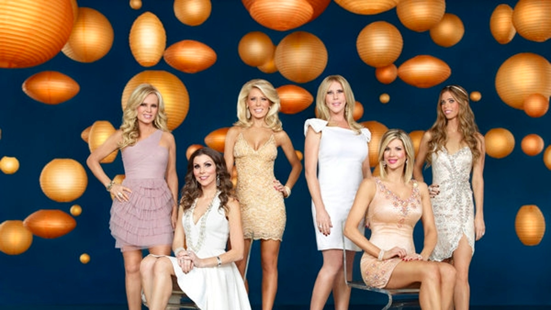 """Tamra Barney, Heather Dubrow, Gretchen Rossi, Vicki Gunvalson, Alexis Bellino, Lydia McLaughlin pose in a """"Real Housewives of Orange County"""" promotional photo."""