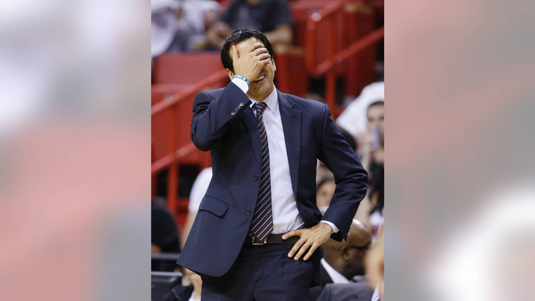 Miami Heat head coach Erik Spoelstra reacts after a call during the second half of an NBA basketball game against the Philadelphia 76ers, Wednesday, April 16, 2014 in Miami. The 76ers defeated the Heat 100-87. (AP Photo/Wilfredo Lee)