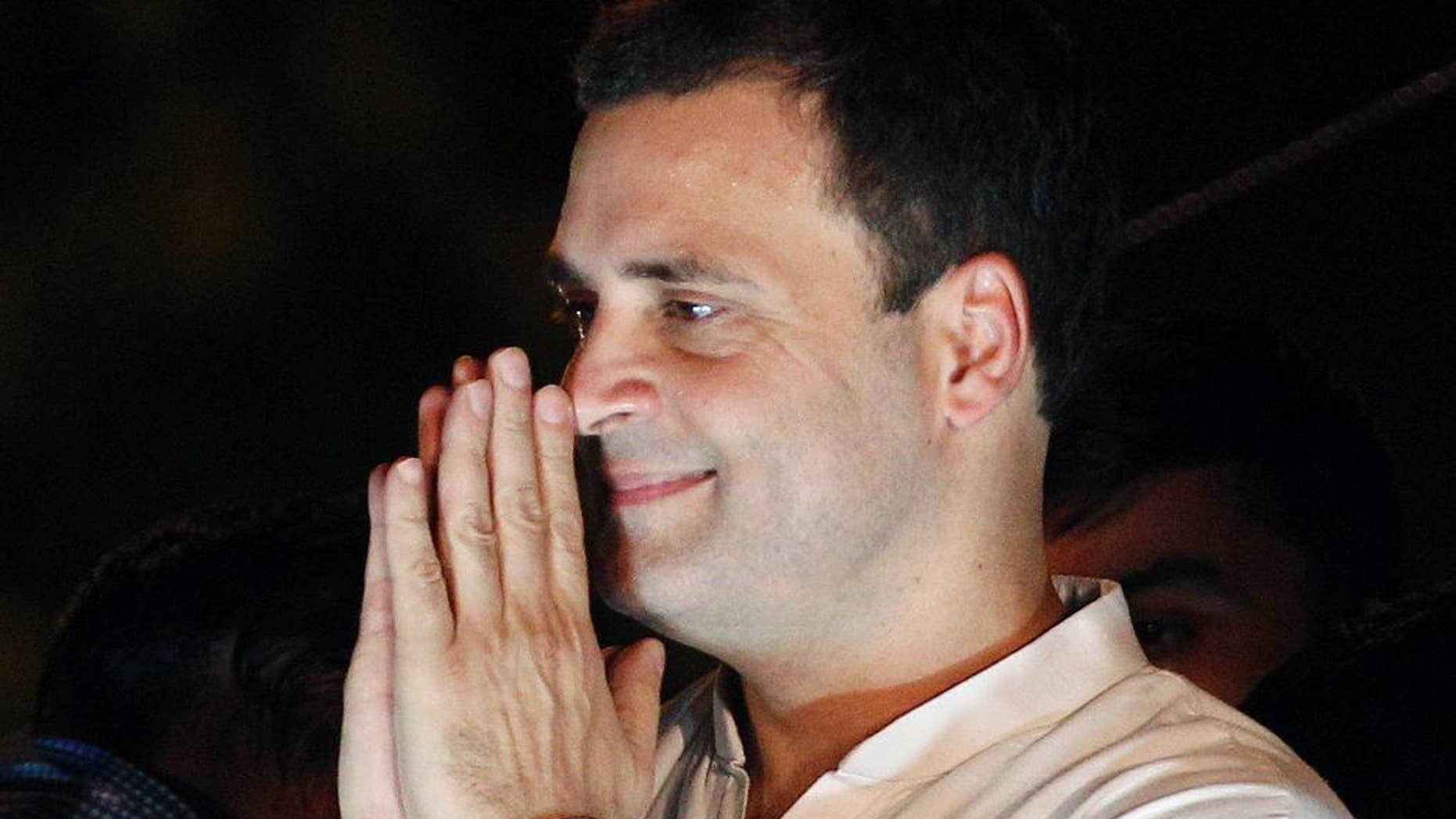 FILE - In this May 28, 2016, file photo, India's opposition Congress party vice-president Rahul Gandhi, greets his supporters during a protest rally against the Aam Aadmi Party or Common Man's Party led Delhi government and India's ruling Bharatiya Janata Party government over power cuts and water shortage in New Delhi, India. India's top court on Tuesday, July 19, 2016, has ordered a scion of India's Nehru-Gandhi family to express regret or face defamation charges for blaming the country's top Hindu nationalist organization for the 1948 assassination of independence leader Mohandas Gandhi. (AP Photo/Altaf Qadri, File)