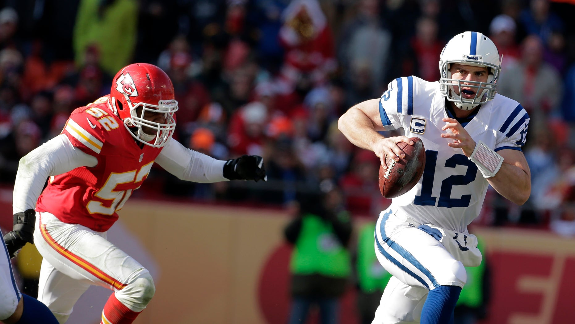 Indianapolis Colts quarterback Andrew Luck, right, scrambles away from Kansas City Chiefs inside linebacker Brandon Siler during the first half of an NFL football game on Sunday, Dec. 23, 2012, in Kansas City, Mo. (AP Photo/Charlie Riedel)
