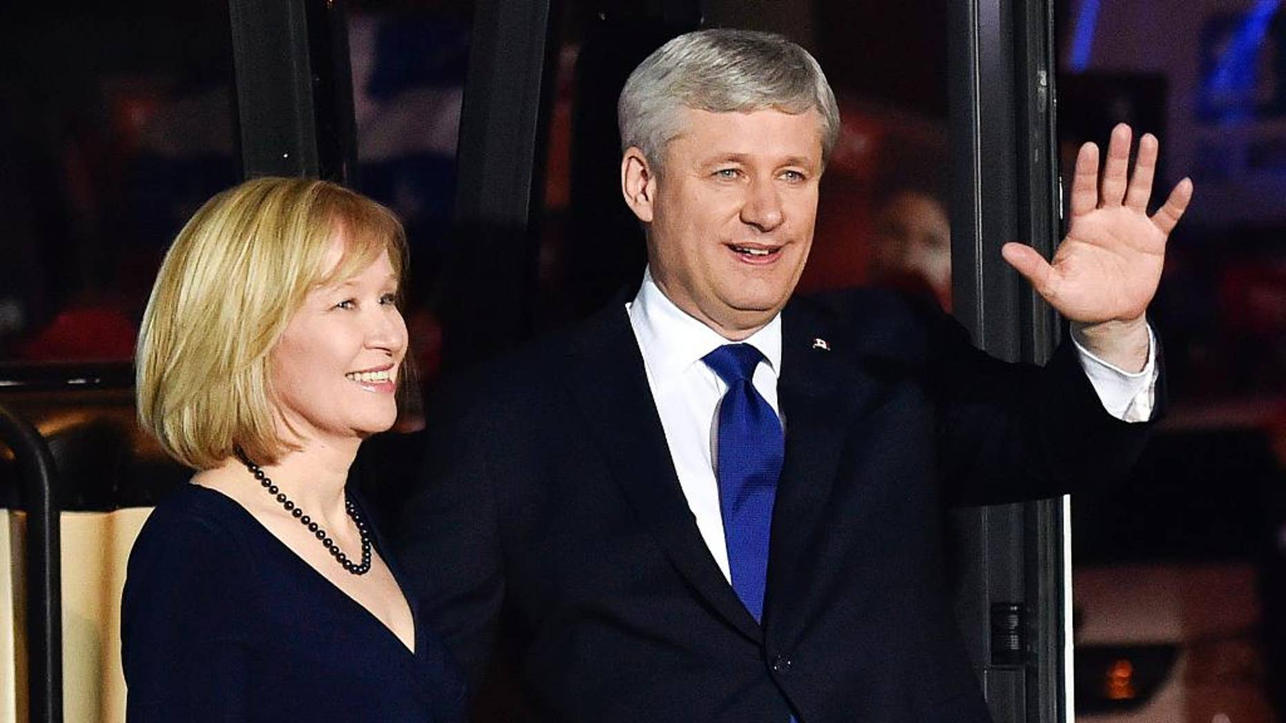 Conservative leader Stephen Harper, right, and his wife Laureen Harper arrive for the final leaders debate in Montreal on Friday, Oct. 2, 2015. (Nathan Denette/The Canadian Press via AP) MANDATORY CREDIT