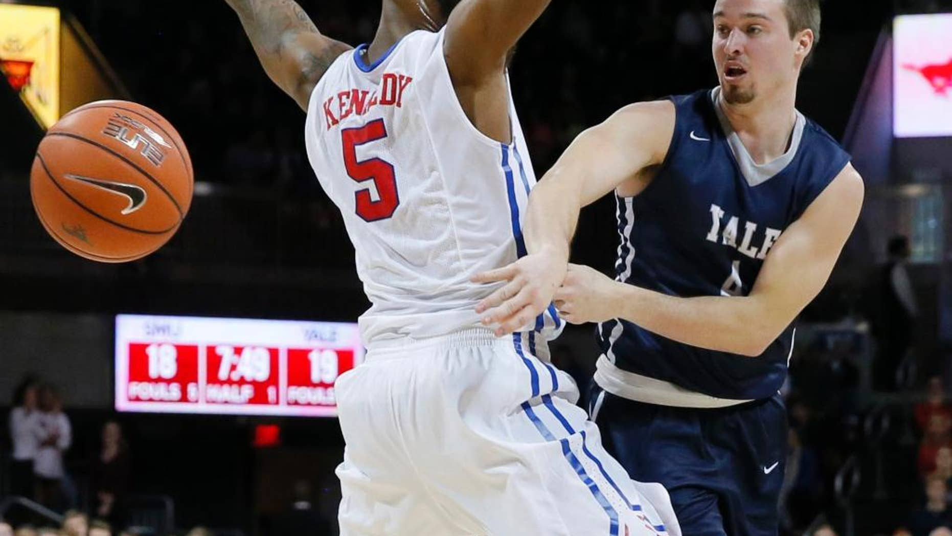 FILE - In this Nov. 22, 2015 FILE photo, Yale's Jack Montague, right, passes the ball around SMU's Markus Kennedy during an NCAA college basketball game in Dallas. Montague's attorney said he was expelled from Yale in Feb. 2016, because of a sexual assault allegation. Montague filed a federal lawsuit over the expulsion, alleging the school mishandled information that originated with someone other than the alleged victim. (AP Photo/Tony Gutierrez, File)