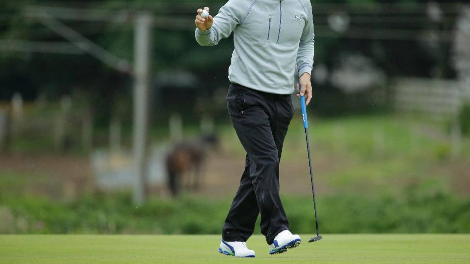 Soren Kjeldsen of Denmark acknowledges the spectators on the 10th green during the second round of the British Open Golf Championship at the Royal Troon Golf Club in Troon, Scotland, Friday, July 15, 2016. (AP Photo/Matt Dunham)