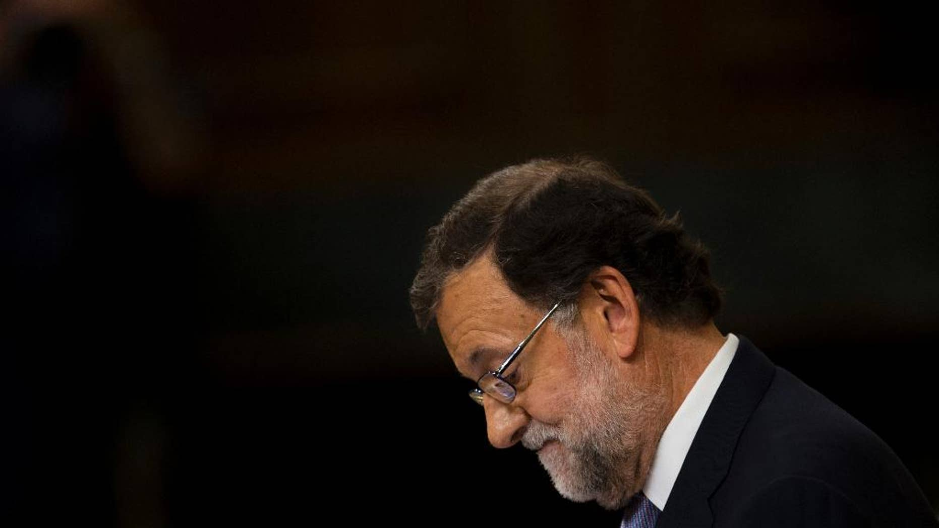 Spain's acting Prime Minister and Popular party leader Mariano Rajoy looks down as he addresses lawmakers during the second of the two day investiture debate, at the Spanish parliament in Madrid, Wednesday, Aug. 31, 2016. Rajoy lost the investiture voting on Wednesday but he has a second chance Friday when he only needs more votes in favor than against. (AP Photo/Francisco Seco)
