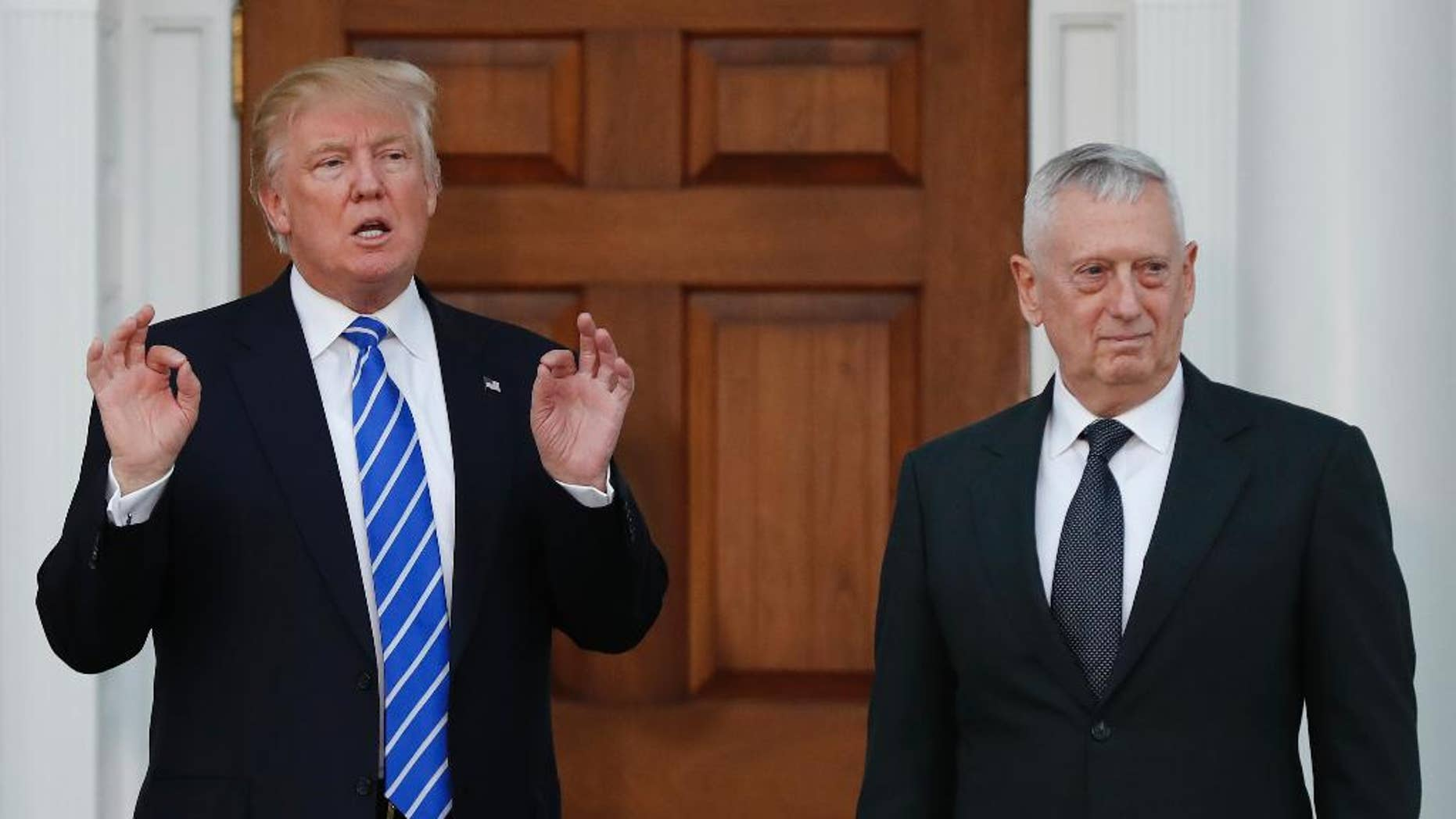 In this photo taken Nov. 19, 2016, Defense Secretary-designate James Mattis stands with President-elect Donald Trump in Bedminster, N.J. Senators signaled little opposition Tuesday, Jan. 10, 2017, to the nomination of Mattis, as national security experts recommended lawmakers amend the law and allow the retired Marine Corps general to head the Pentagon for President-elect Donald Trump. (AP Photo/Carolyn Kaster)