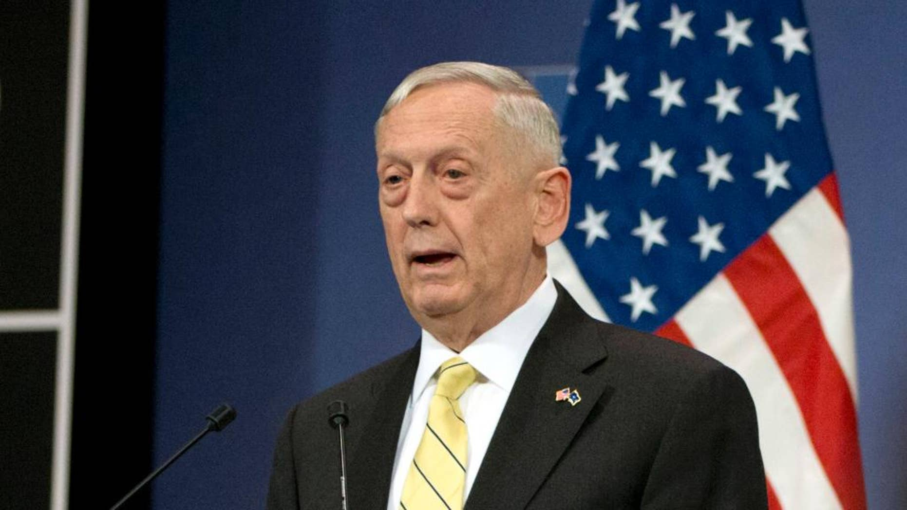 FILE - In this Feb. 16, 2017 file photo, Defense Secretary Jim Mattis speaks in Brussels. Mattis is not lonely in the Pentagon, but two months into his tenure as secretary of defense not a single political appointee has joined him. The retired Marine general, who took office just hours after President Donald Trump was sworn in, has battled the White House over choices for high-priority civilian positions that, while rarely visible to the public, are key to developing and implementing defense policy at home and abroad.  (AP Photo/Virginia Mayo, File)
