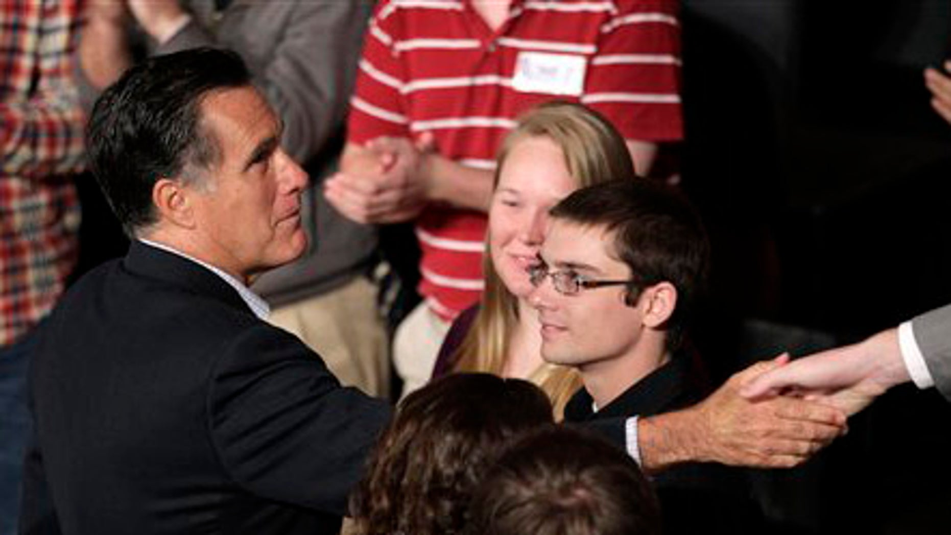 Friday, April 27, 2012: Mitt Romney shakes hands with students at Otterbein University in Westerville, Ohio.