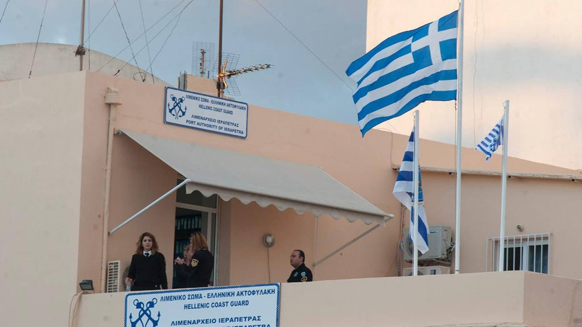 Nov. 25, 2014: Coast guards officials take a break at the Port Authority of Ierapetra on the southeast coast of the Greek island of Crete. (AP)