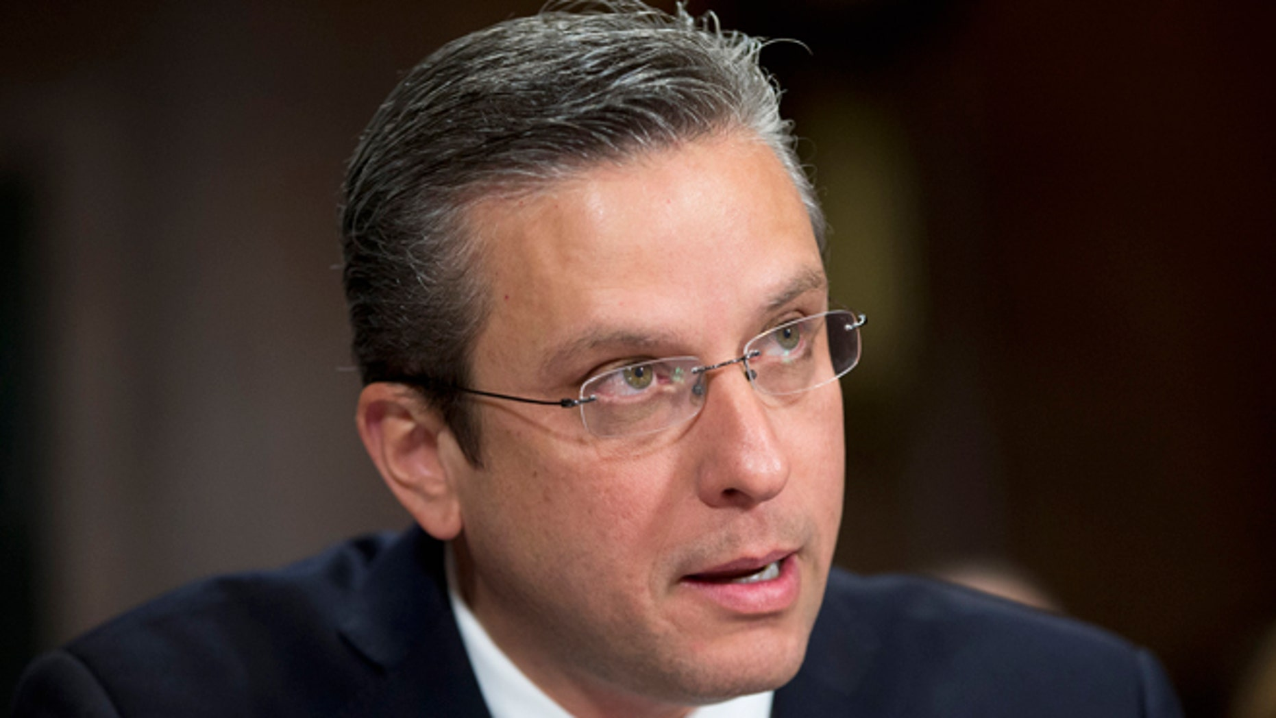 Puerto Rico Gov, Alejandro Javier Garcia Padilla testifies on Capitol Hill in Washington, Tuesday, Dec. 1, 2015, before the Senate Judiciary Committee hearing on Puerto Rico's fiscal problems. Puerto Rico and its debt crisis takes center stage in Congress as its governor testifies before a Senate panel about the U.S. commonwealth's financial woes and the demands of creditors.(AP Photo/Pablo Martinez Monsivais)