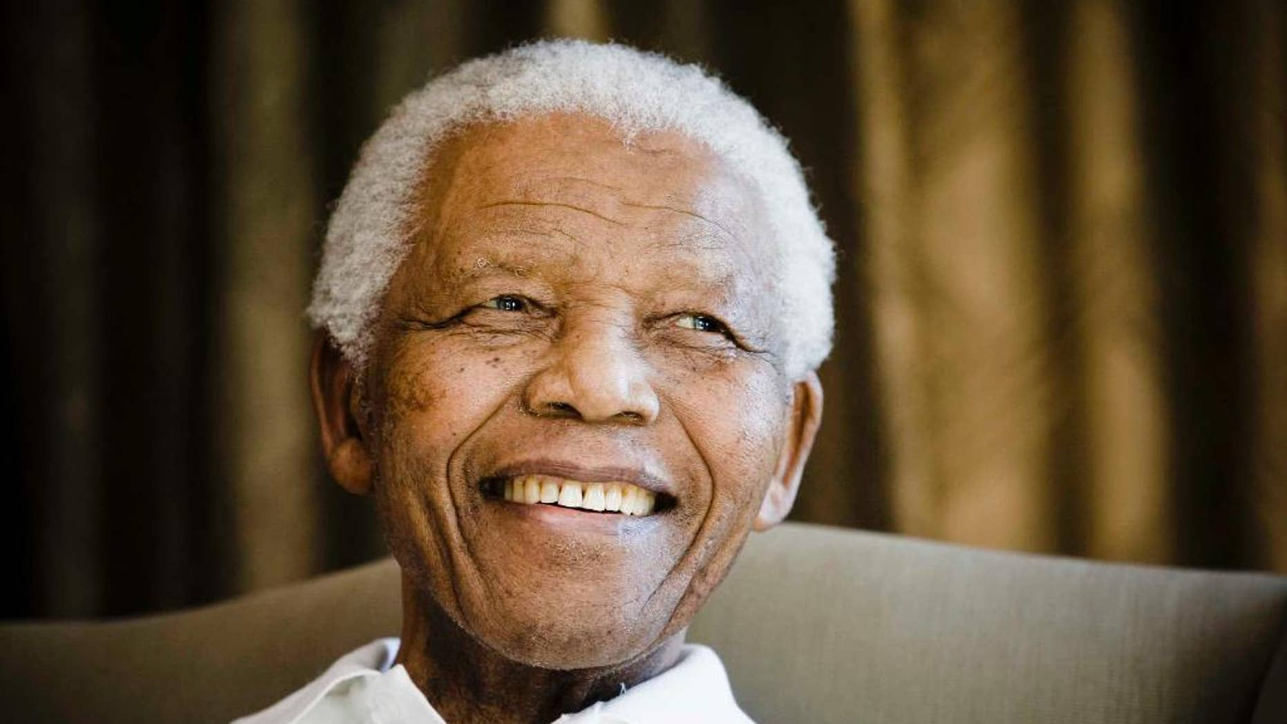 June 2, 2009: Former South African President Nelson Mandela smiles during a meeting with a group of American and South African students in Johannesburg.